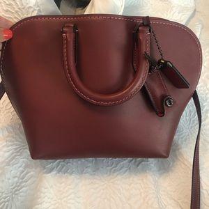 Beautiful burgundy coach handbag
